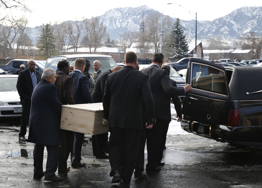 FILE - In this Dec. 9, 2016, file photo, pallbearers carry the casket for late Heisman Trophy winner and former Colorado running back R...