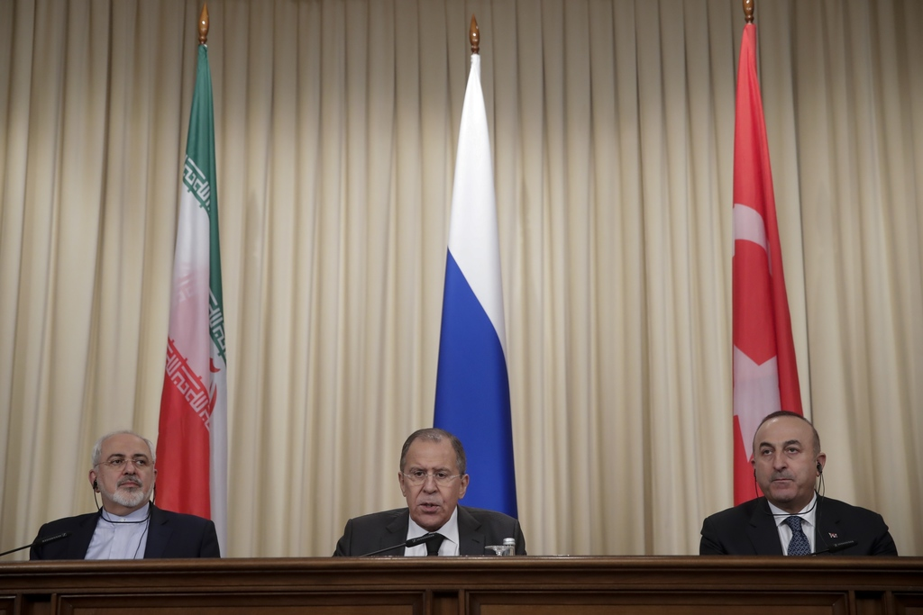 FILE - In this Tuesday, Dec. 20, 2016 file photo, Iranian Foreign Minister Mohammad Javad Zarif, left, Russian Foreign Minister Sergey ...
