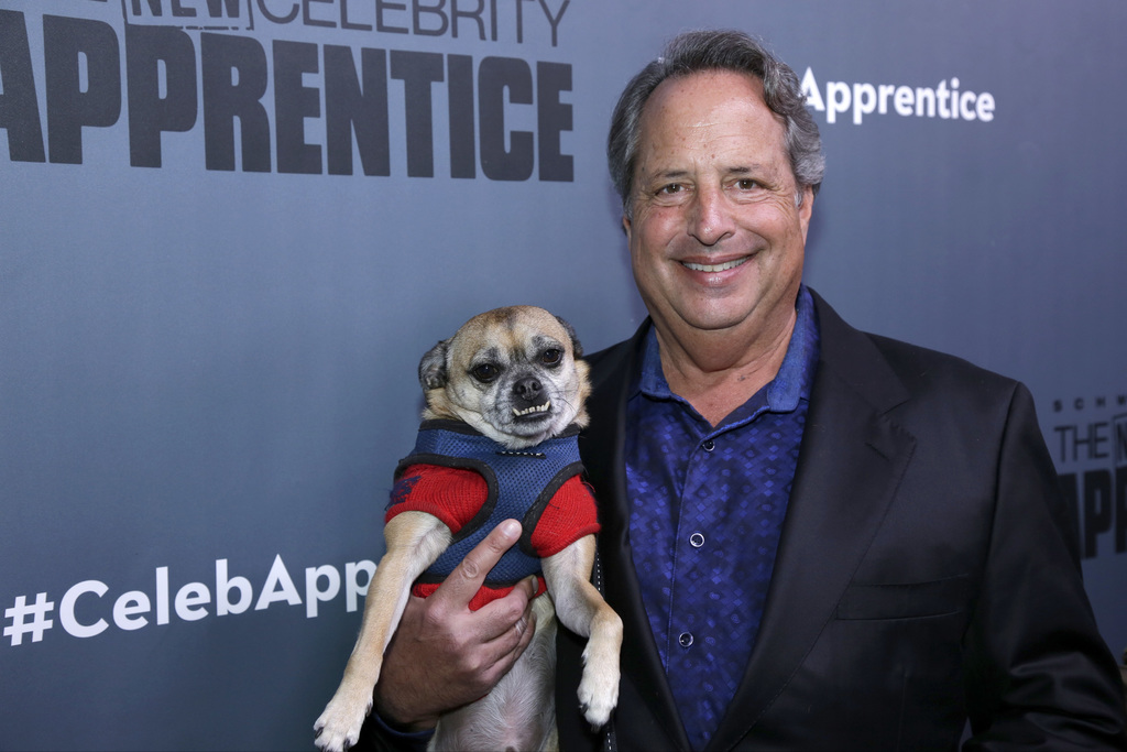 """This Dec. 9, 2016 photo released by NBC shows Jon Lovitz, a contestant on """"The New Celebrity Apprentice,"""" at a press junket in Universa..."""