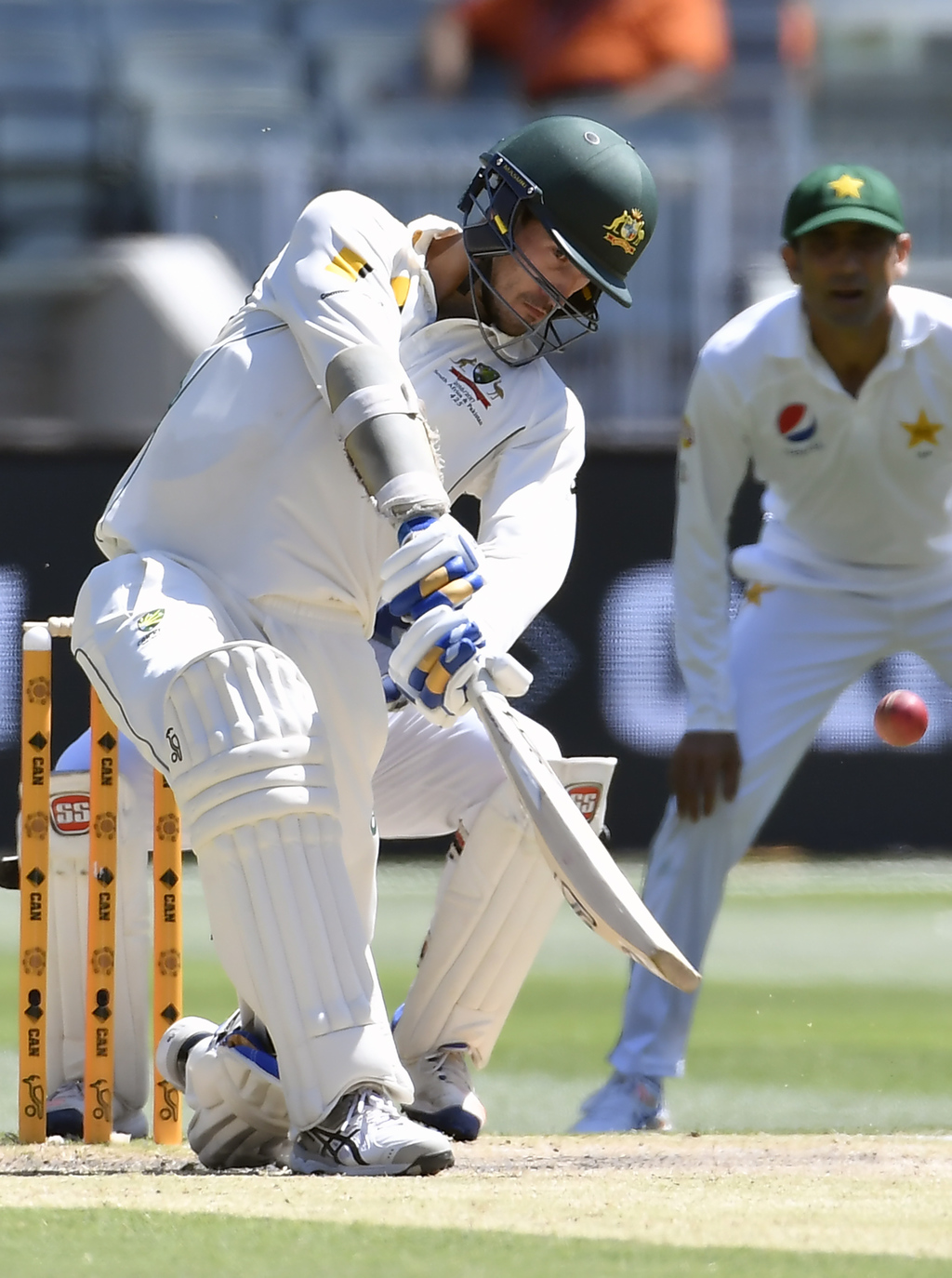 Australia's Mitchell Starc hits a six against the bowling of Pakistan's Azhar Ali on the fifth day of their second cricket test in Melb...