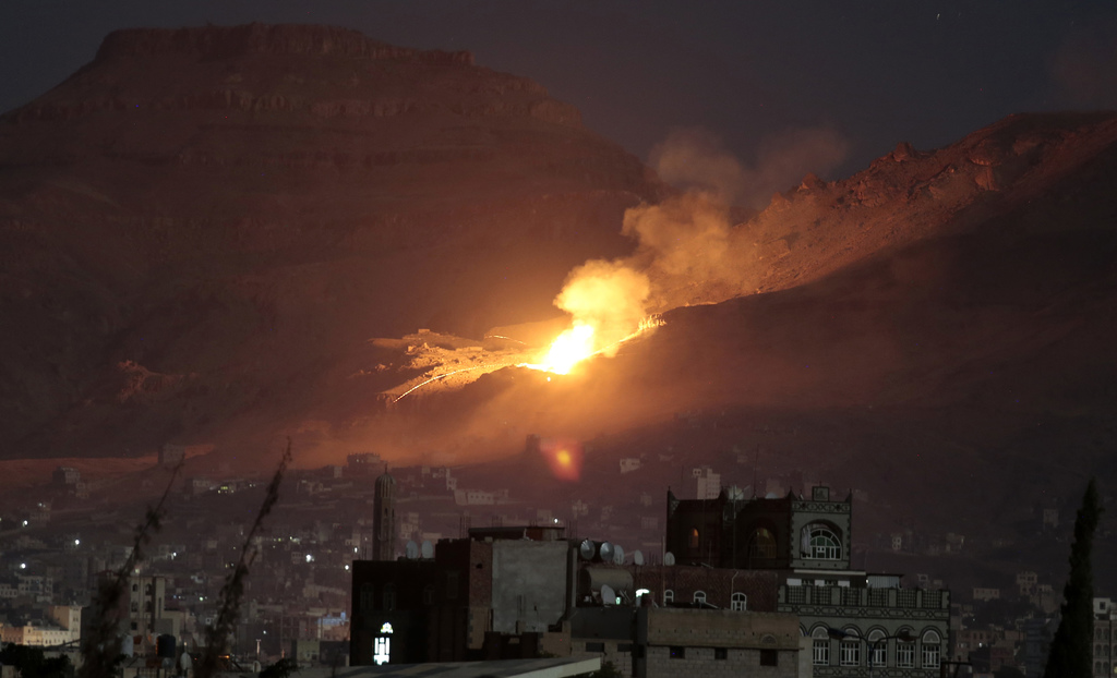 FILE - Fire and smoke rise after a Saudi-led airstrike hit a site believed to be one of the largest weapons depots on the outskirts of ...