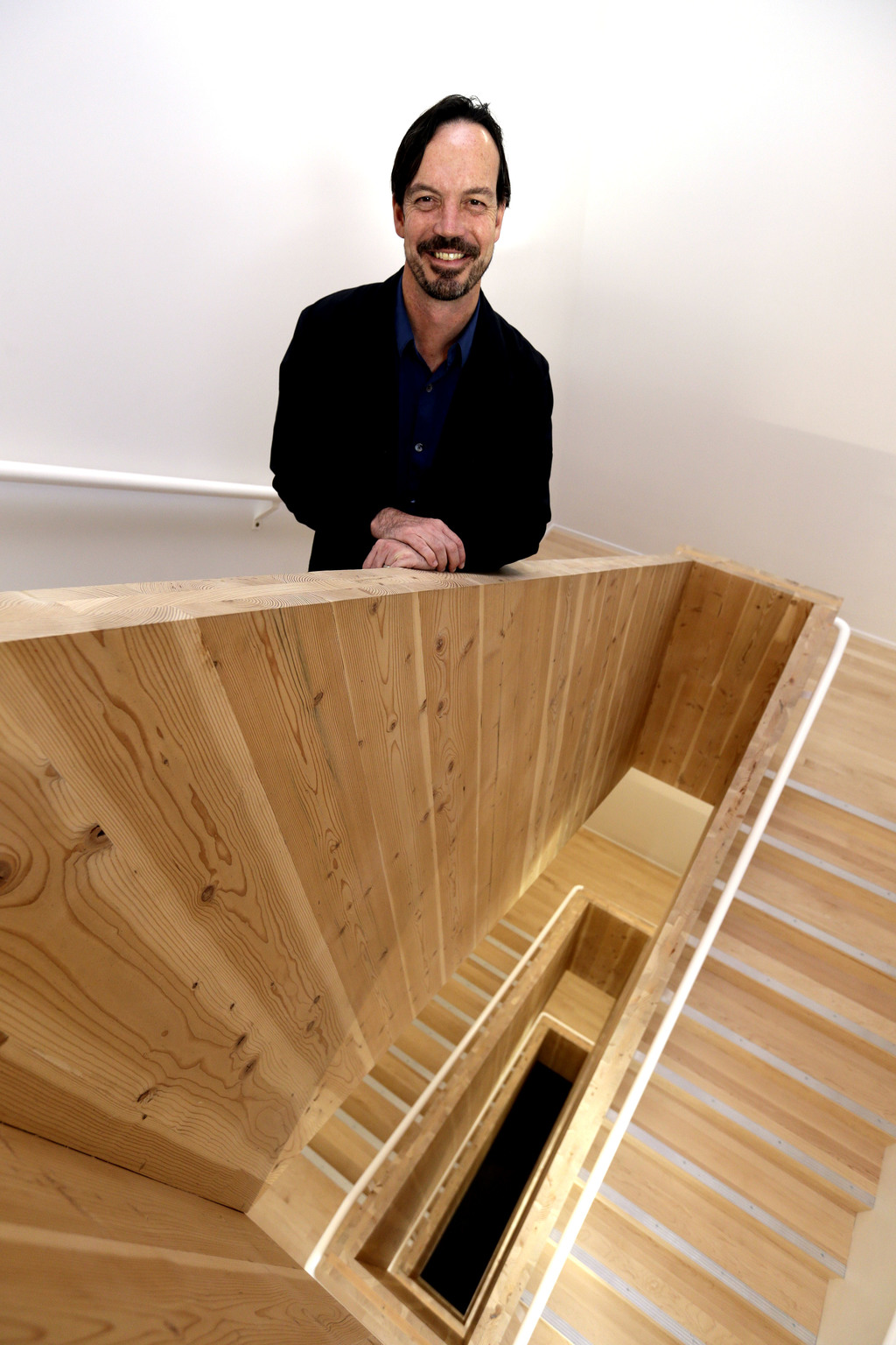In this Nov. 15, 2016, photo, Lever Architecture founder Thomas Robinson poses for a photo in his company's all-wood headquarters build...
