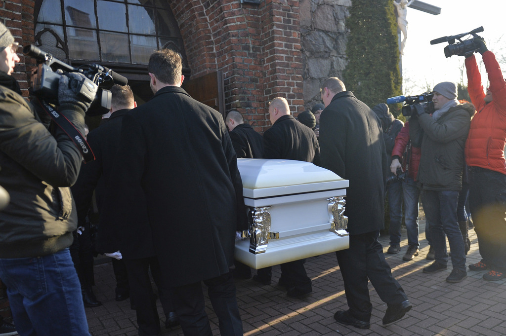 The coffin with the body of Lukasz Urban, the Polish truck driver killed in the Berlin Christmas market attack, is carried into the chu...