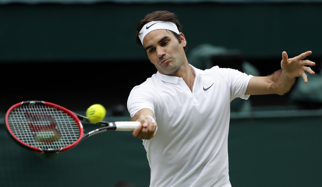 FILE - In this July 8, 2016, file photo, Roger Federer of Switzerland returns to Milos Raonic of Canada during their men's semifinal si...