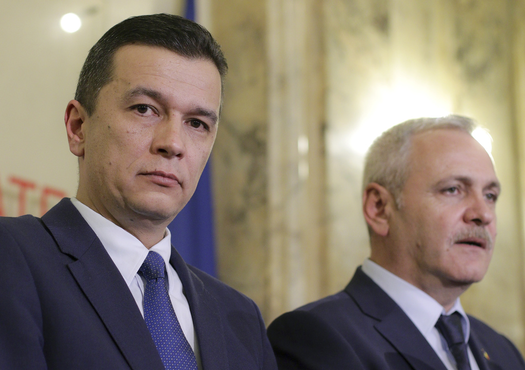 In this photo dated Wednesday Dec. 28, 2016, Sorin Grindeanu, left, Romania's Prime Minister designate stands next to Liviu Dragnea, th...