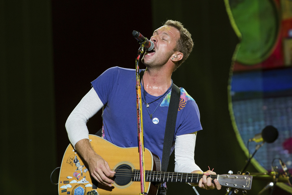 FILE - In this Sept. 4, 2016, file photo, Chris Martin of Coldplay performs at The Budweiser Made In America Festival in Philadelphia. ...