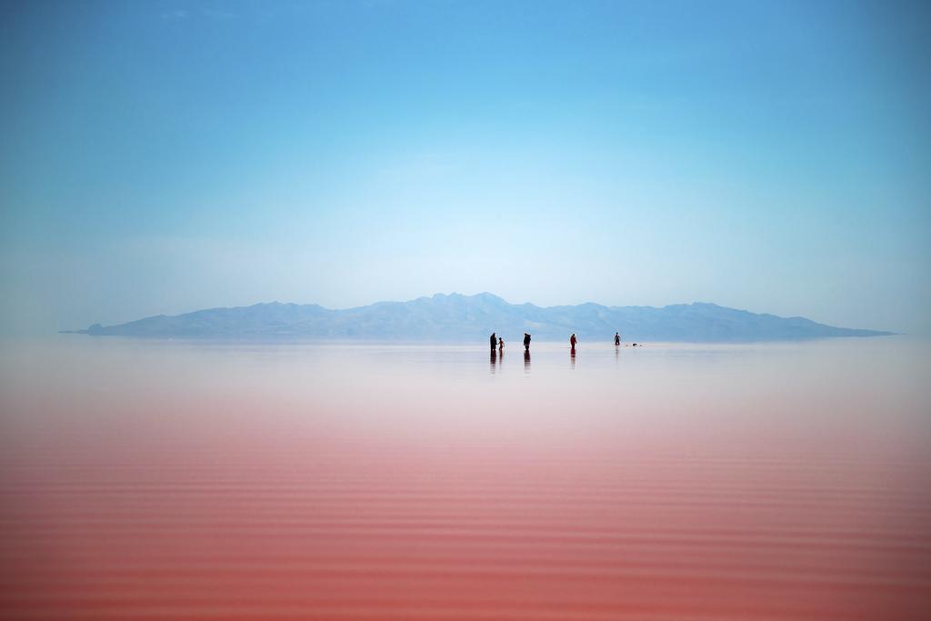 FILE - Iranians spend time in Urmia Lake near Urmia, North-western Iran, Friday, Aug. 26, 2016. (AP Photo/Ebrahim Noroozi, File)       ...