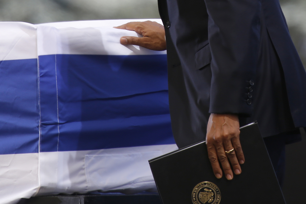 FILE - U.S. President Barack Obama touches the flag-draped coffin of former Israeli President Shimon Peres during his funeral at the Mo...