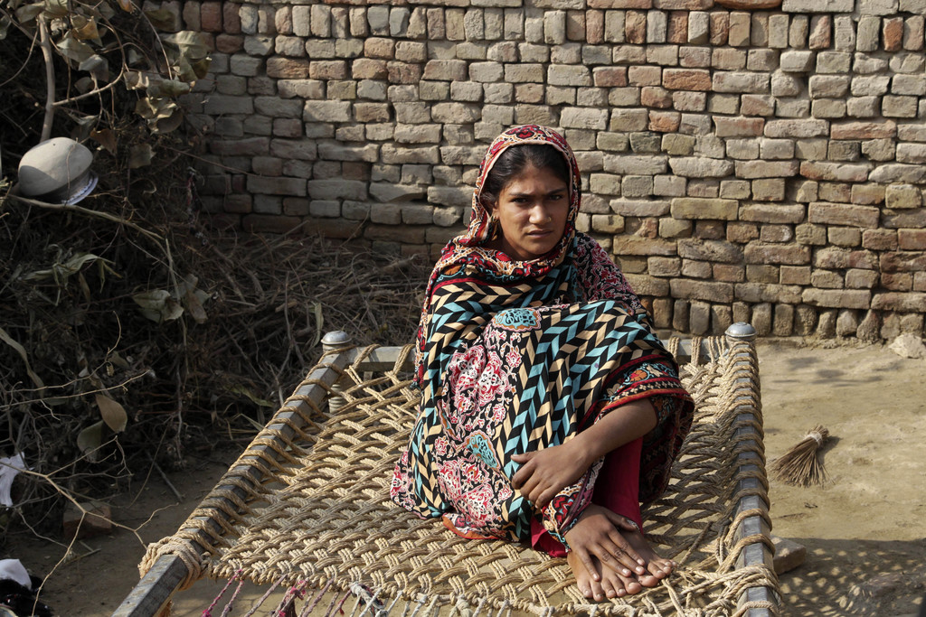 In this Tuesday, Dec. 20, 2016 photo, Saima, who was married to a 36 year-old man in her early teens, sits in her home in Jampur, Pakis...