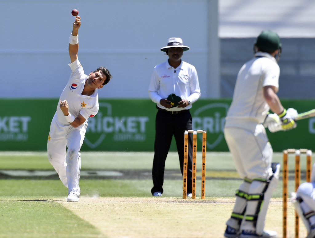 Pakistan's Yasir Shah, left, bowls to Australian captain Steve Smith, right, on the fifth day of their second cricket test in Melbourne...