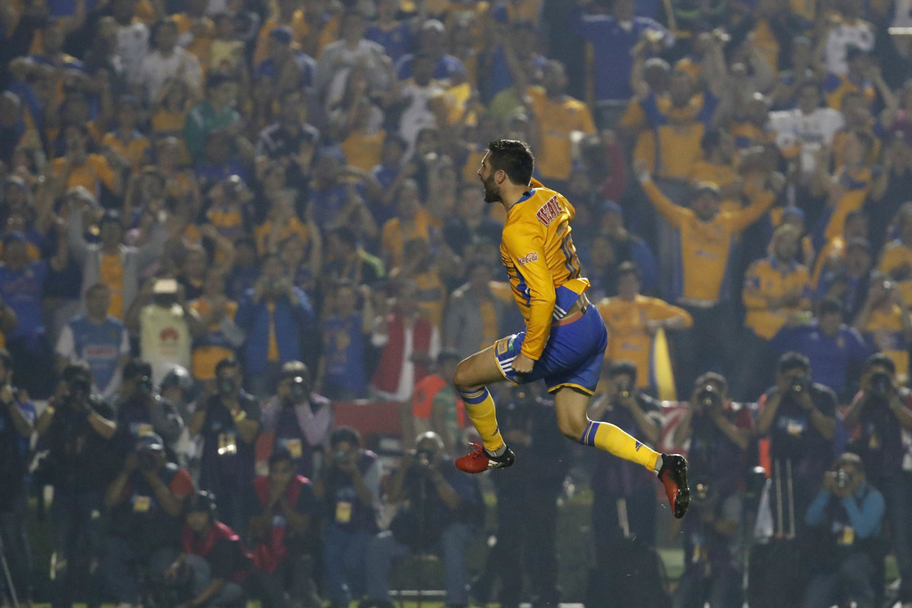 In this Sunday, Dec. 25, 2016 photo, Tigres' Andre Pierre Gignac celebrates after scoring during a penalty shootout against America dur...