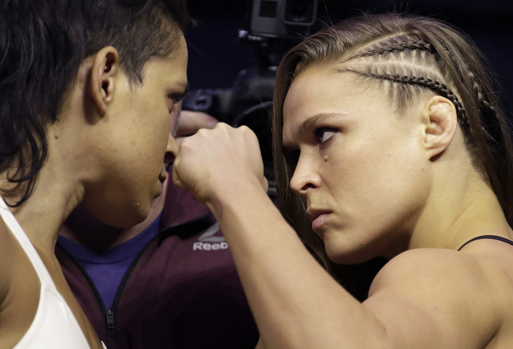 Ronda Rousey, right, and Amanda Nunes face off for photographers during an event for UFC 207, Thursday, Dec. 29, 2016, in Las Vegas. Ro...