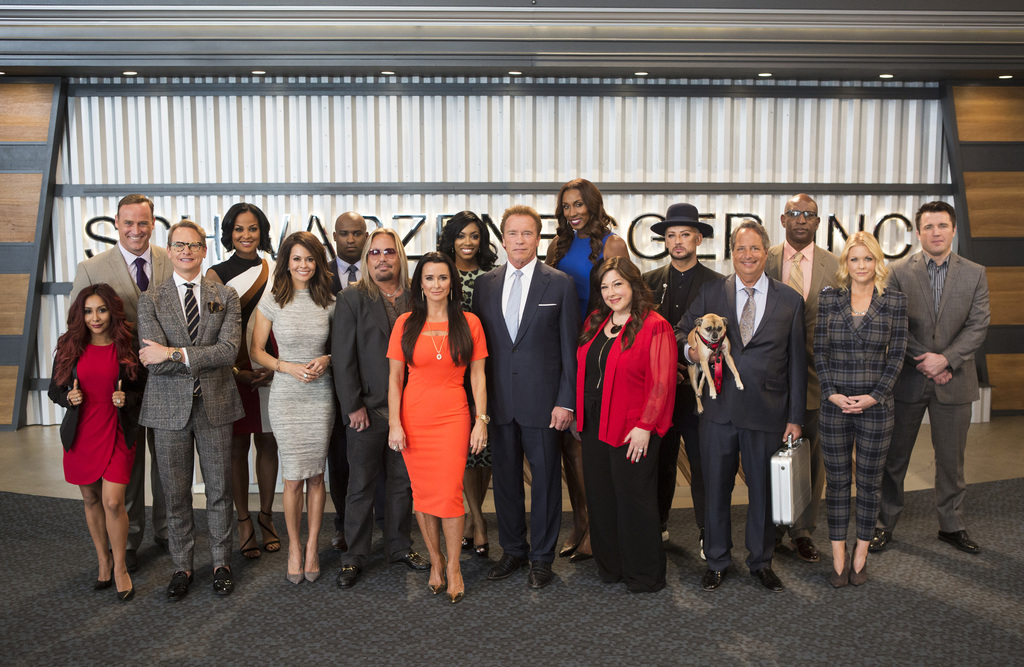 """This image released by NBC shows the cast of """"The New Celebrity Apprentice,"""" back row from left, Matt Iseman, Laila Ali, Ricky Williams..."""