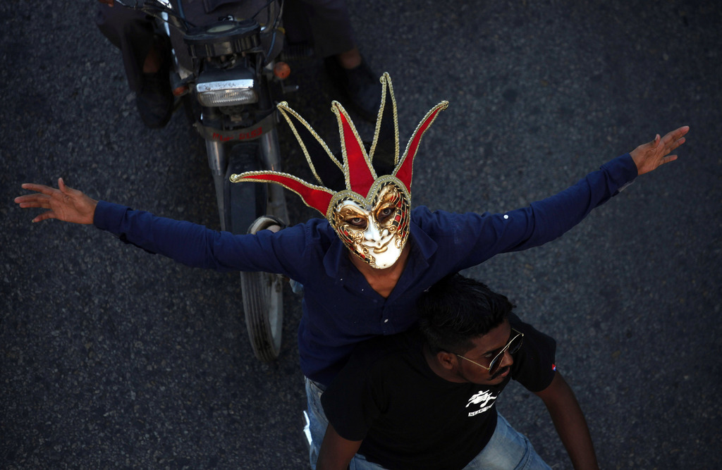 FILE - A Pakistani Christian wears mask while participating in a peace rally in connection with a Christmas celebration, in Karachi, Pa...