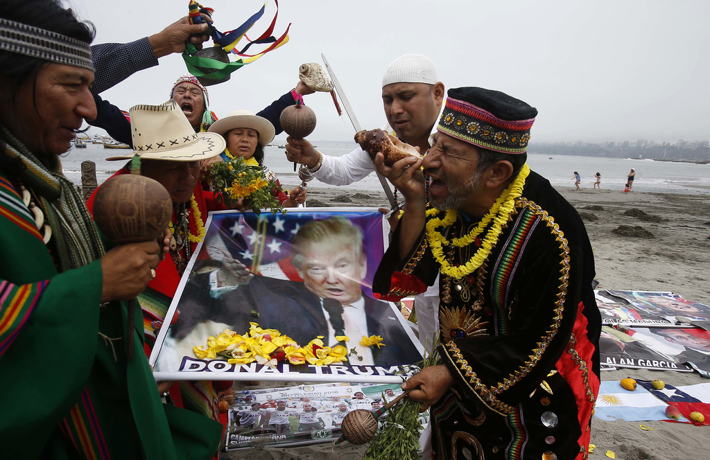 In this Thursday, Dec. 29, 2016 photo, a group of shamans perform their pre-year cleansing ritual holding a poster of President-elect D...