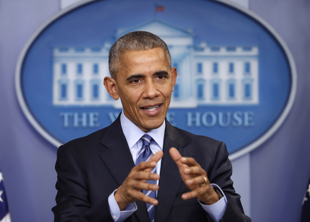 In this photo taken Dec. 16, 2016, President Barack Obama speaks during a news conference in the briefing room of the White House in Wa...