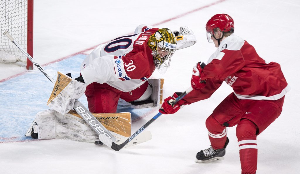 Czech Republic goaltender Daniel Vladar makes a save off Denmark's Joachim Blichfeld during the first period of a world junior hockey c...