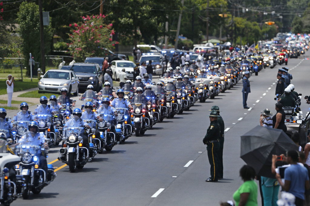 FILE - In this July 25, 2016 file photo, the funeral procession for slain Baton Rouge police Corporal Montrell Jackson leaves the Livin...