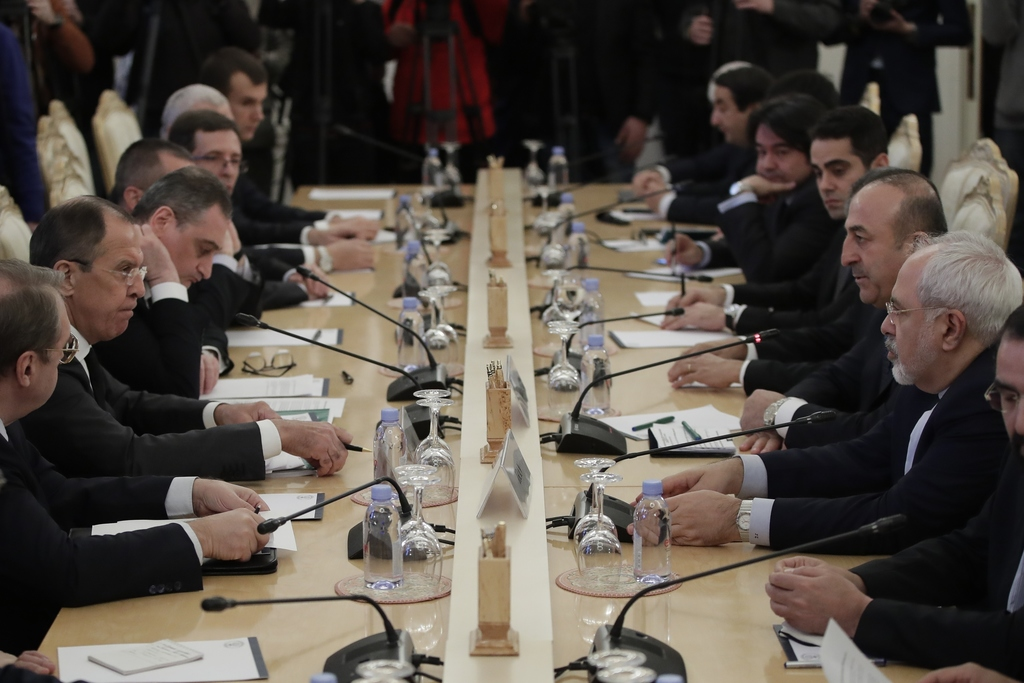 FILE - This Tuesday, Dec. 20, 2016 file photo, Turkey's Foreign Minister Mevlut Cavusoglu, second right, and Iranian Foreign Minister M...