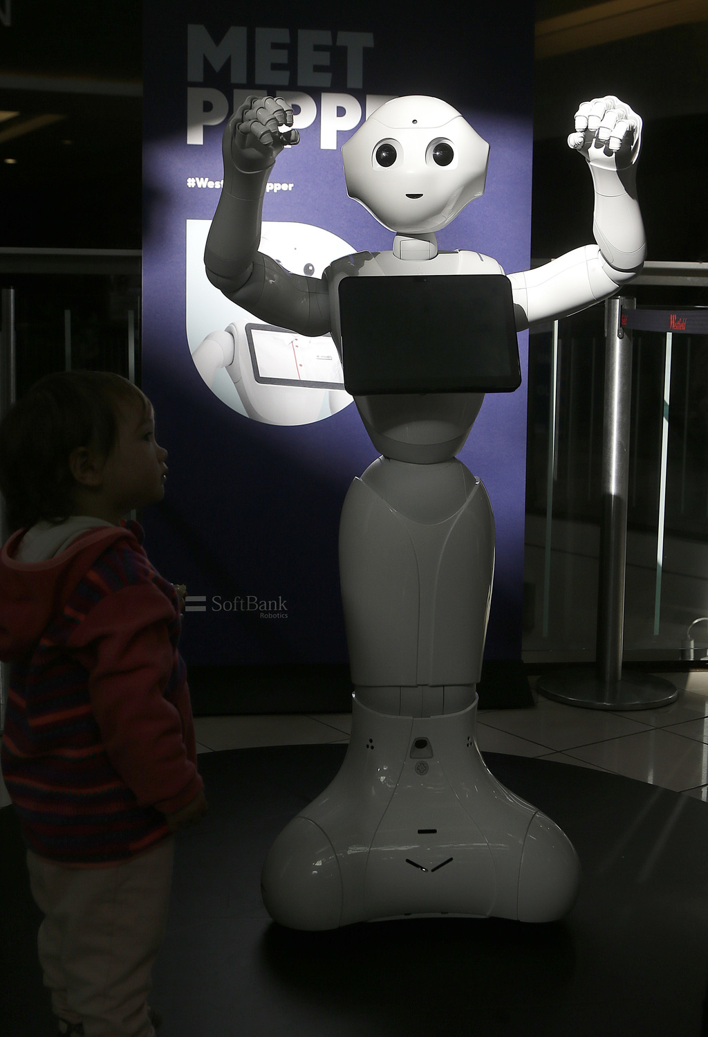 FILE - This Thursday, Dec. 22, 2016, file photo, shows Pepper the robot at Westfield Mall in San Francisco. The SoftBank Robotics human...