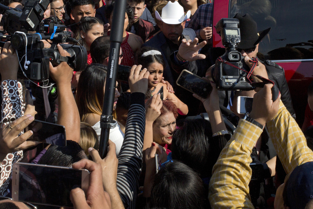 In this Monday, Dec. 26, 2016 photo, surrounded by a horde of journalists Rubi Ibarra arrives at the site of a Mass that is part of her...