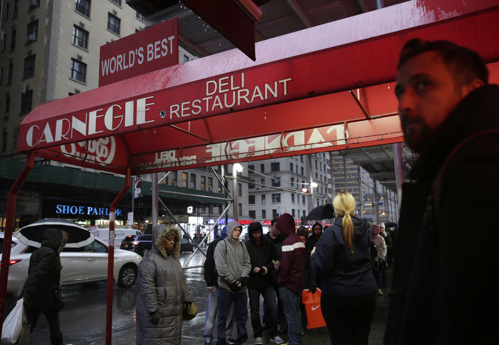 People wait in line to eat at the Carnegie Delicatessen in New York, Thursday, Dec. 29, 2016. After 79 years of serving up heaps of cur...