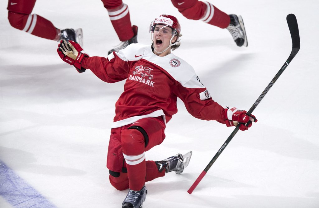 Denmark's Mathias From celebrates after scoring the winning goal in overtime period to beat the Czech Republic in a world junior hockey...