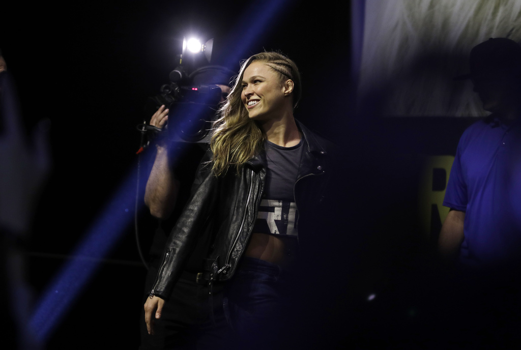 Ronda Rousey walks on stage during an event for UFC 207, Thursday, Dec. 29, 2016, in Las Vegas. Rousey is scheduled to fight Amanda Nun...