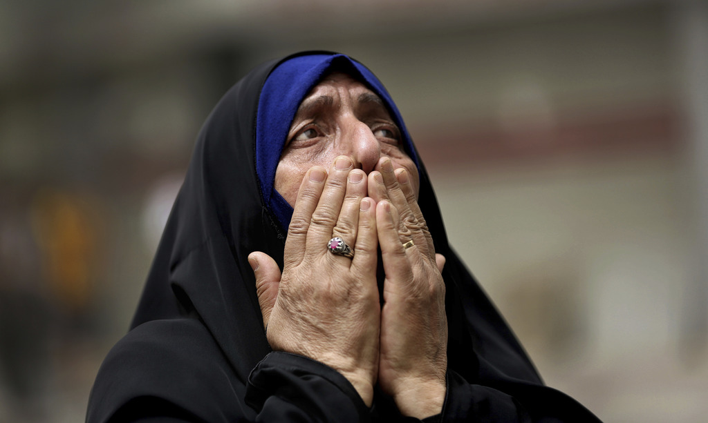 FILE - An Iraqi woman grieves at the scene after a truck bomb attack in Karradah, a busy shopping district in the center of Baghdad, Ir...