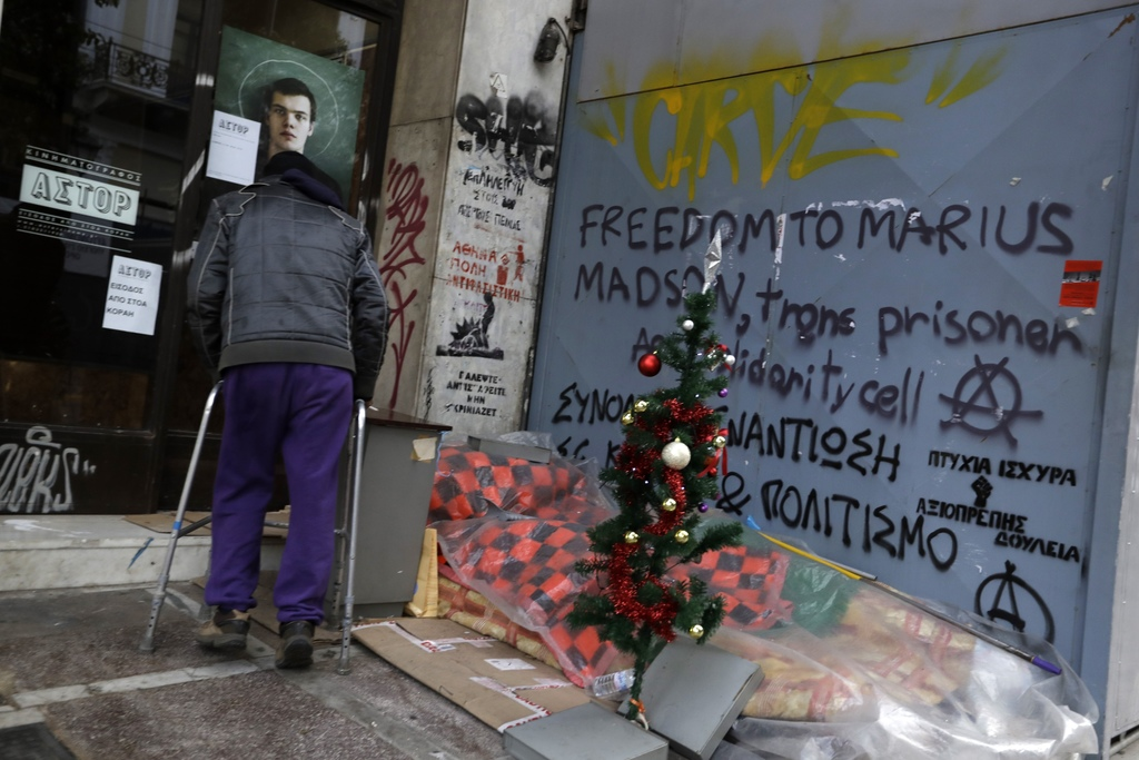 In this photo taken on Wednesday, Dec. 21, 2016, a homeless person has placed a Christmas tree in central Athens. Nearly one-in-four Gr...