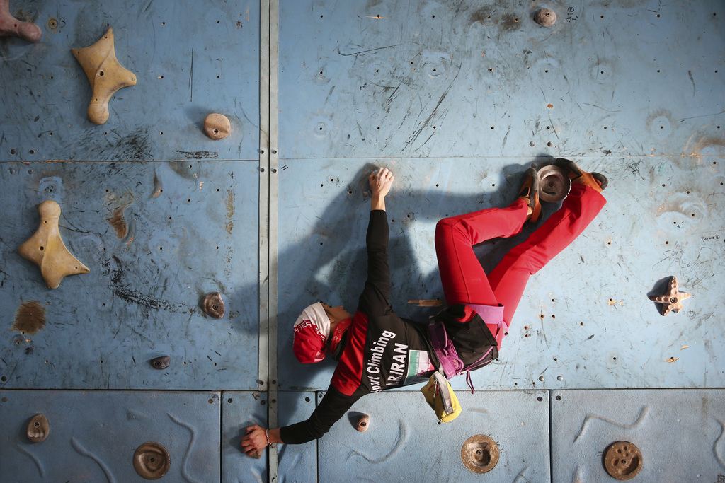 FILE - In this Monday, Jan. 18, 2016 photo, Iranian rock climber, Farnaz Esmaeilzadeh, scales a climbing gym in the city of Zanjan, som...