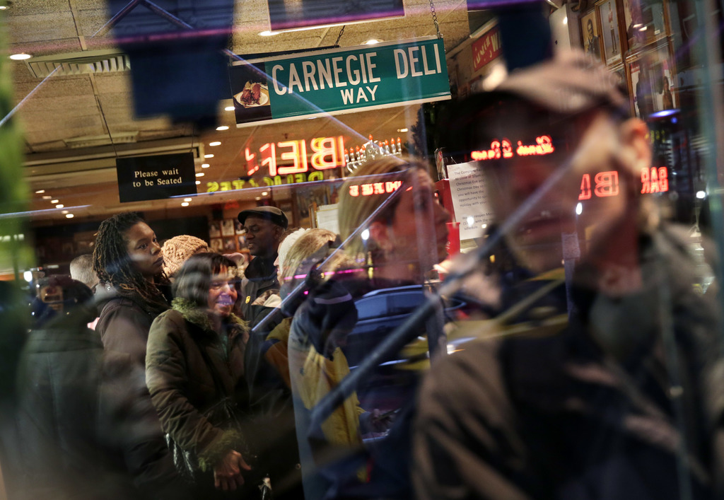 People wait in line, both inside and outside, to eat at the Carnegie Delicatessen in New York, Thursday, Dec. 29, 2016. After 79 years ...