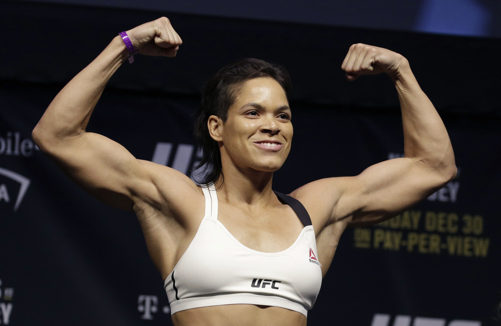 Amanda Nunes poses for photographers during an event for UFC 207, Thursday, Dec. 29, 2016, in Las Vegas. Nunes is scheduled to fight Ro...