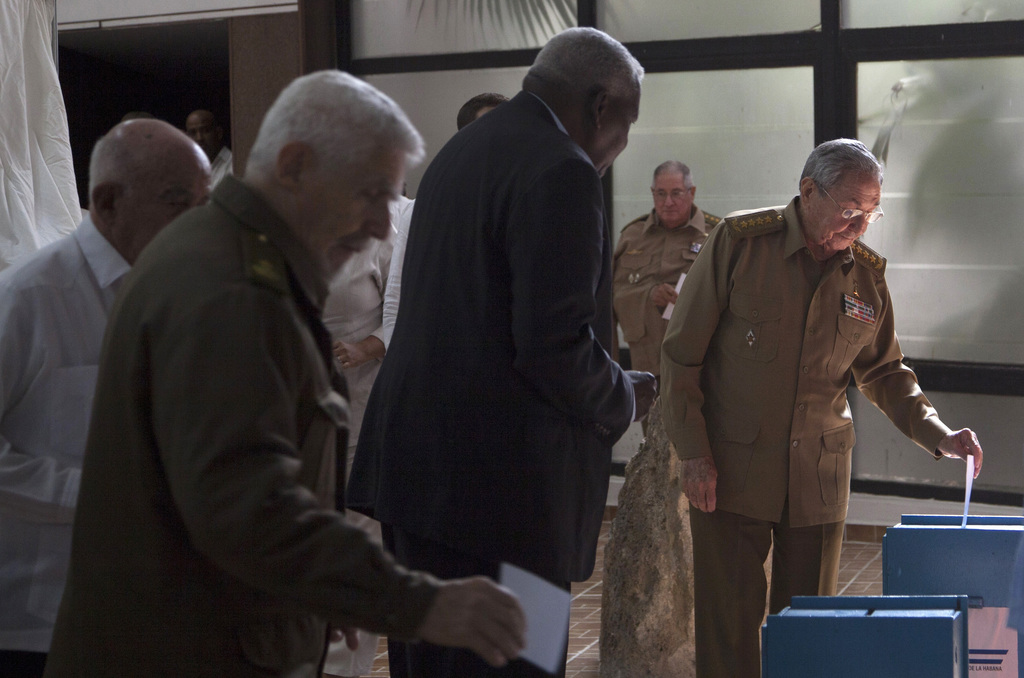 In this Tuesday, Dec. 27, 2016 photo, Cuba's President Raul Castro casts his vote to elect a new member of the state council, the biann...