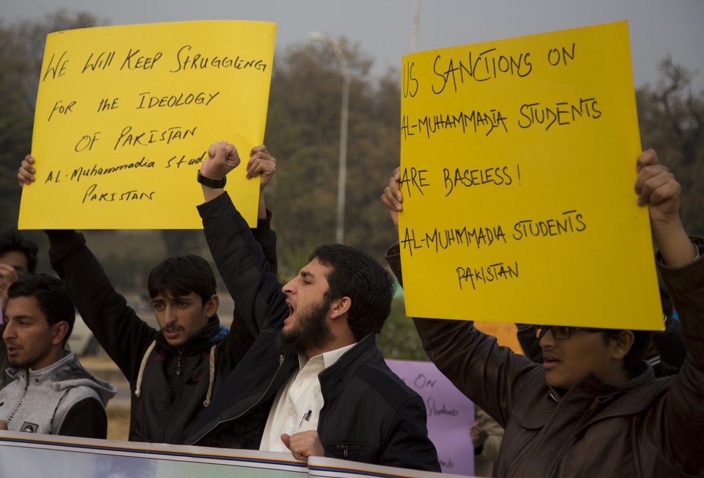 Pakistani students affiliated with Pakistani religious group shout anti-American slogans at a rally in Islamabad, Pakistan, Friday, Dec...