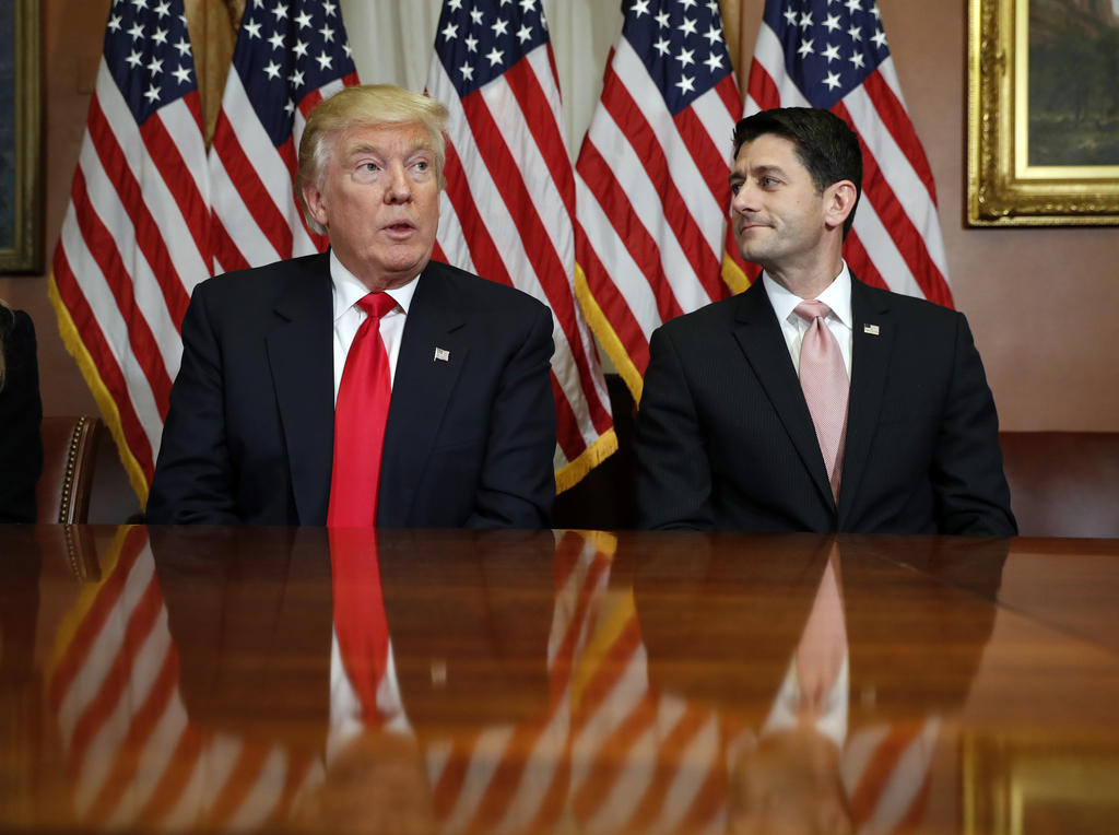 FILE - In this Nov. 10, 2016 file photo, President-elect Donald Trump and House Speaker Paul Ryan of Wis., pose for photographers after...