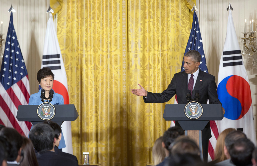 FILE - In this Oct. 16, 2015 file photo, U.S. President Barack Obama, right, gestures toward South Korean President Park Geun-hye durin...