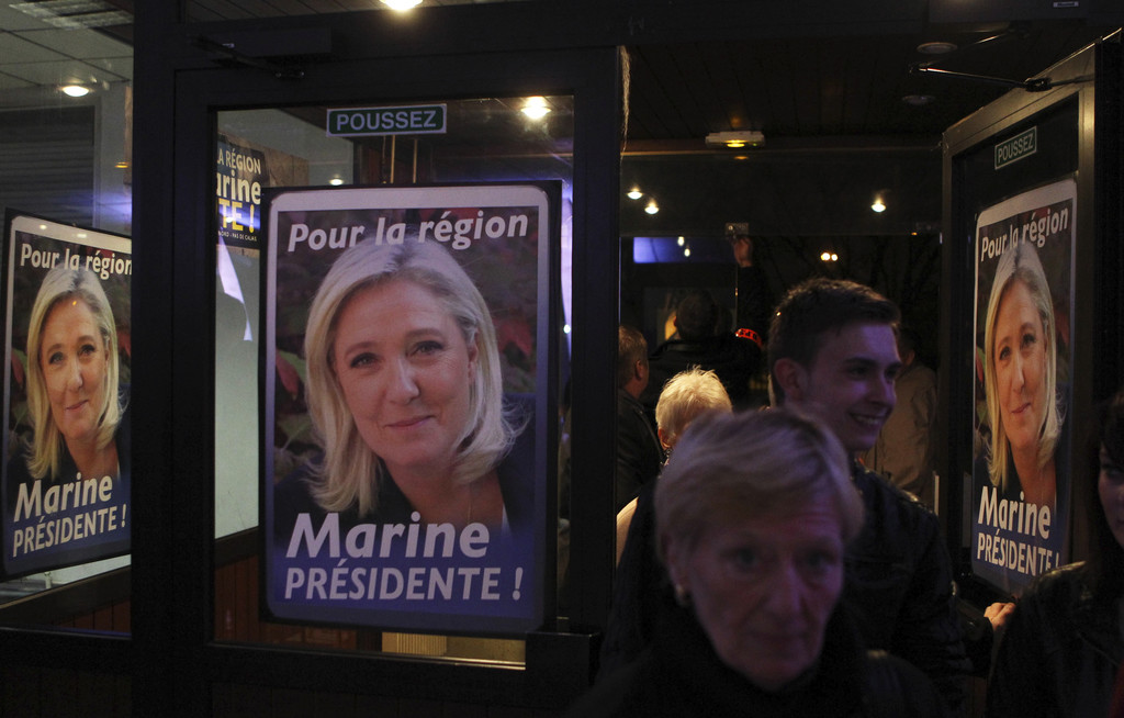 FILE - In this Nov. 6, 2015 file photo, supporters arrive before a meeting with the French far-right National Front party leader Marine...