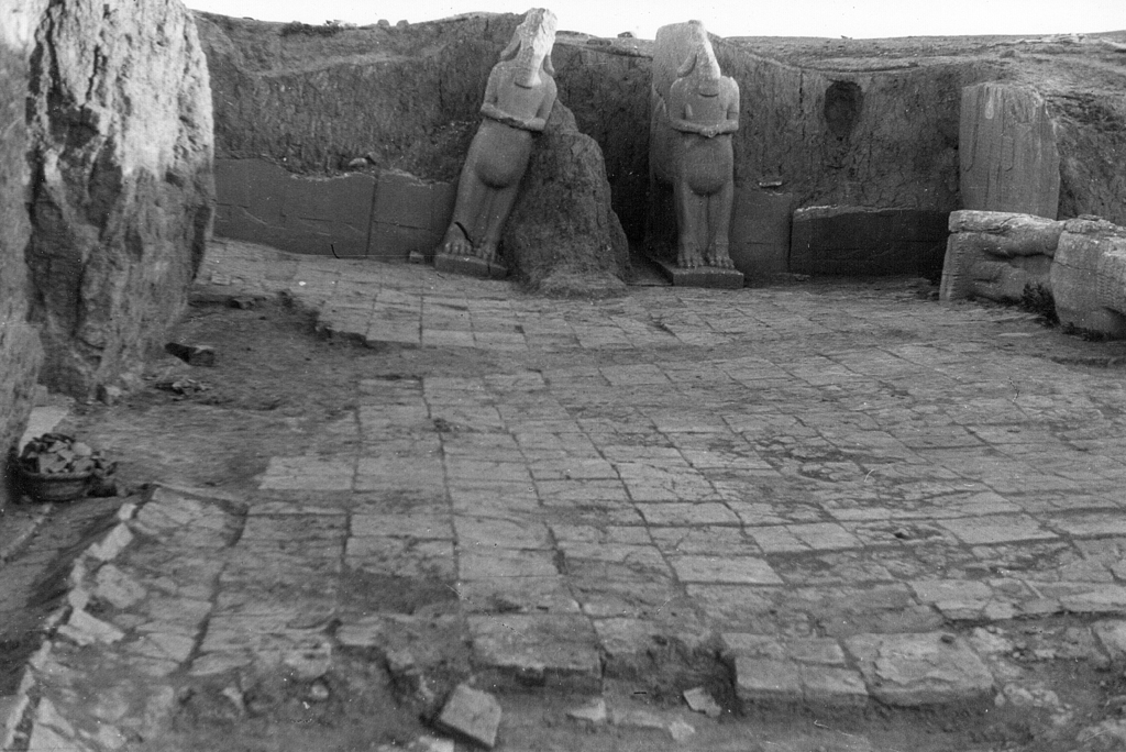 This undated photo taken by mystery writer Agatha Christie shows statues of two Assyrian winged bull deities called lamassu stand at th...