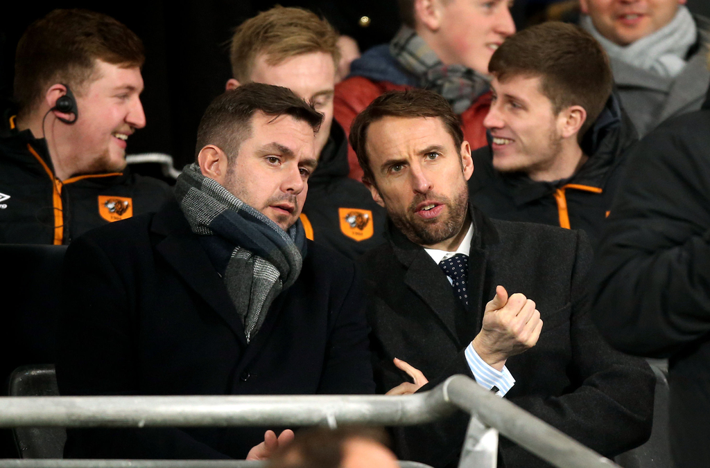 England's soccer team manager Gareth Southgate, front right, observes from the stands during the English Premier League soccer match be...