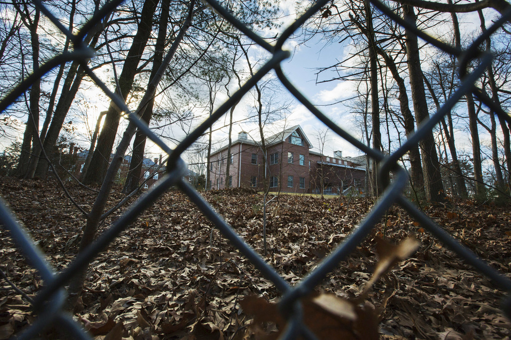 A fence encloses an estate in the village of Upper Brookville in the town of Oyster Bay, N.Y., on Long Island on Friday, Dec. 30, 2016....