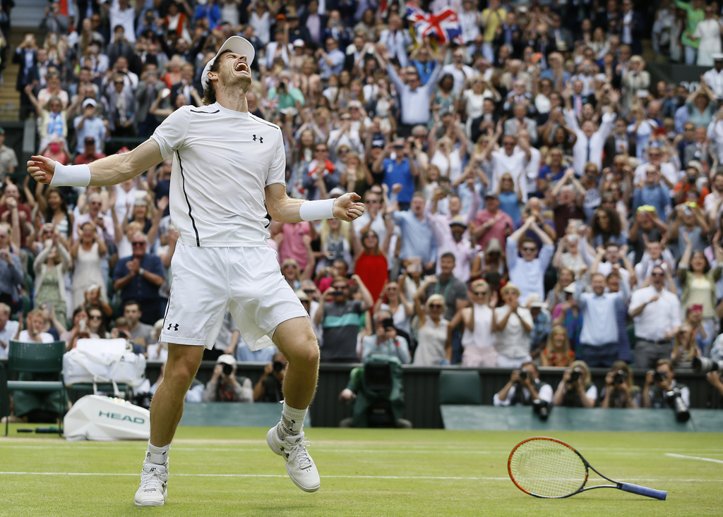 FILE - In this file photo dated Sunday, July 10, 2016, Andy Murray of Britain celebrates after beating Milos Raonic of Canada in the me...