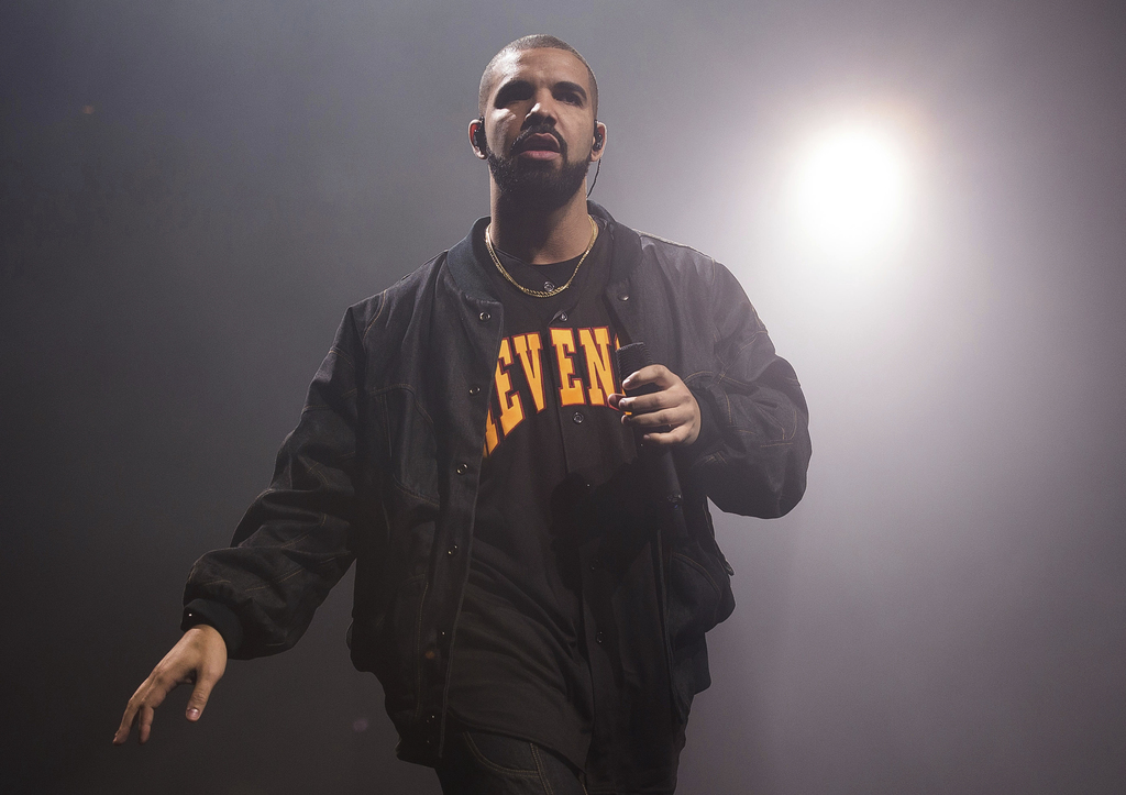 FILE - In this Aug. 5, 2016, file photo, Drake performs in concert as part of the Summer Sixteen Tour in New York. Photos and videos po...