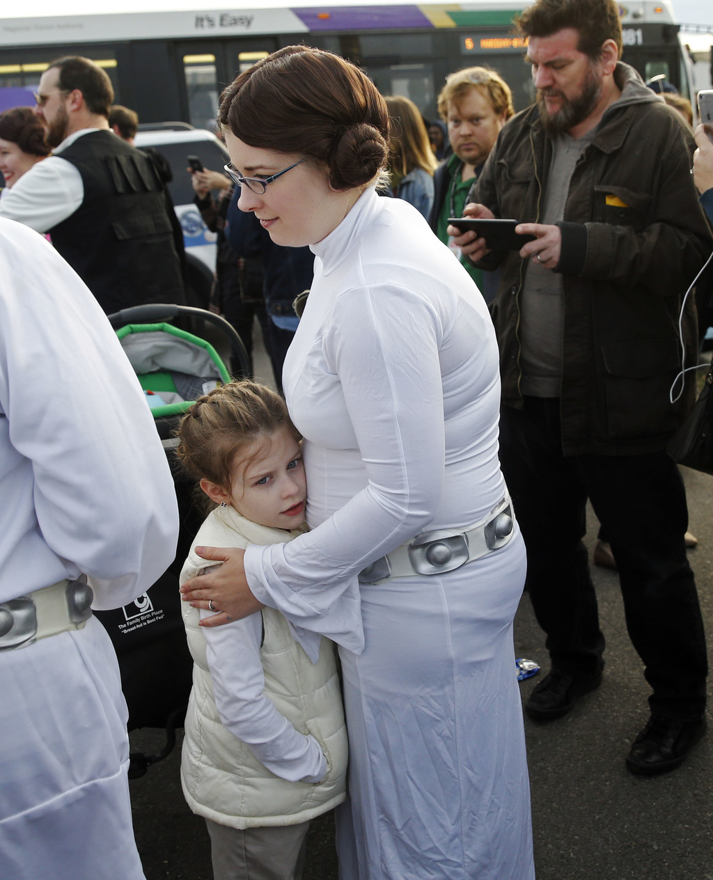 """Laura Bell, dressed as Princess Leia from the original """"Star Wars"""" movie, holds her daughter Luna Bell, dressed as Leia from """"The Empir..."""
