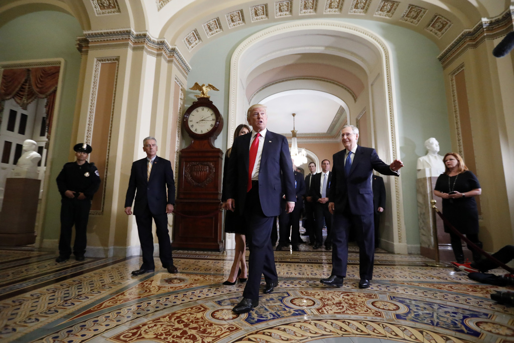 FILE - In this Nov. 10, 2016 file photo, President-elect Donald Trump, center, walk with Senate Majority Leader Mitch McConnell of Ky. ...