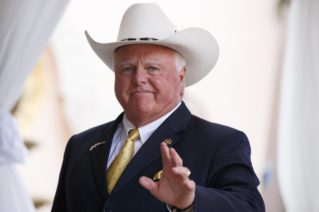Texas Agriculture Commissioner Sid Miller waves as he arrives at Mar-a-Lago to meet with President-elect Donald Trump's transition team...