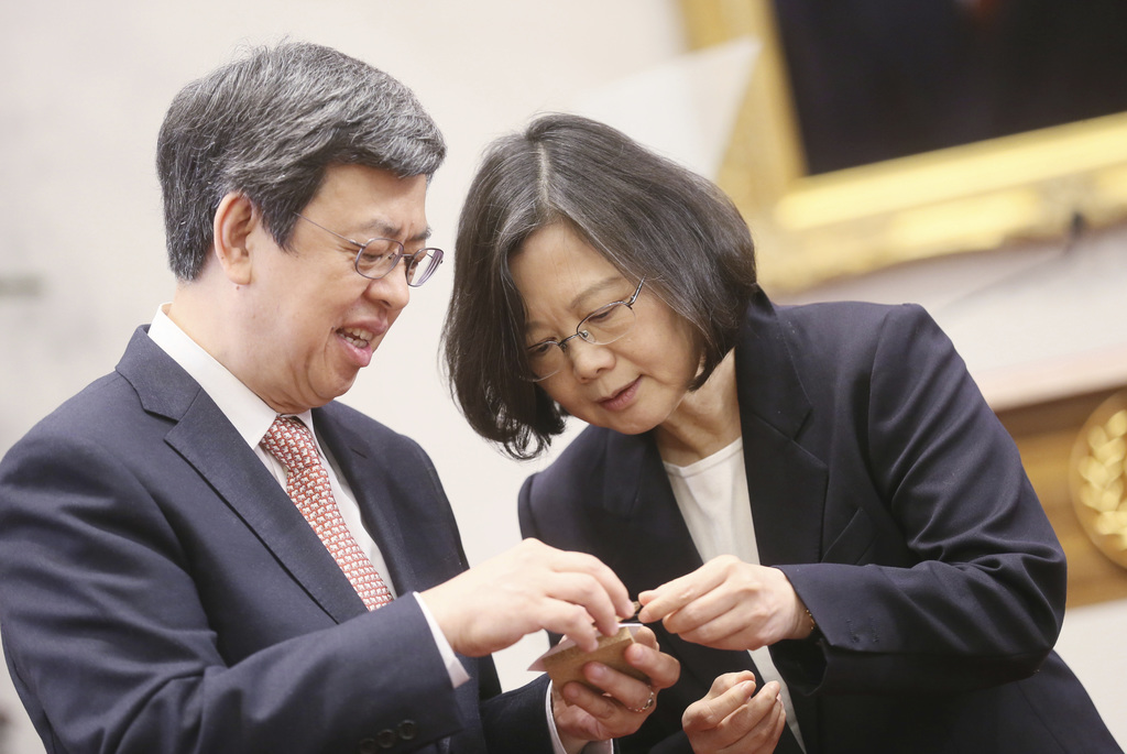 In this photo released by the Taiwan Presidential Office, President Tsai Ing-wen, right, and Vice President Chen Chien-jen look through...