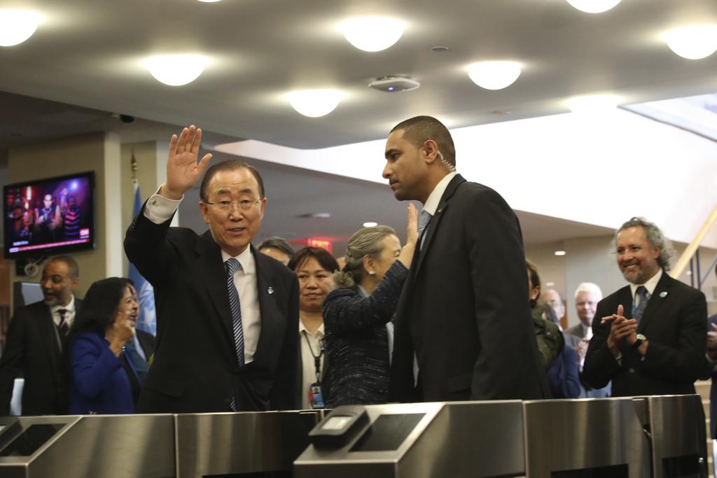 United Nations Secretary-General Ban Ki-moon waves to his staff on his last day at the U.N. headquarters, Friday, Dec. 30, 2016. (AP Ph...