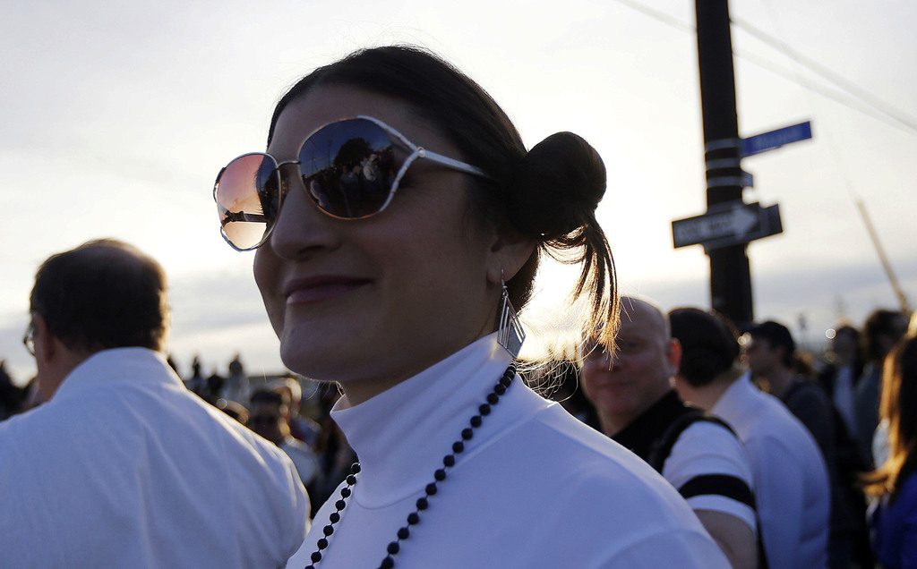 Michell Niemeyer, dressed as Princess Leia, silhouetted as members of the Krewe of Chewbacchus, a Mardi Gras Krewe, hold a parade, in h...