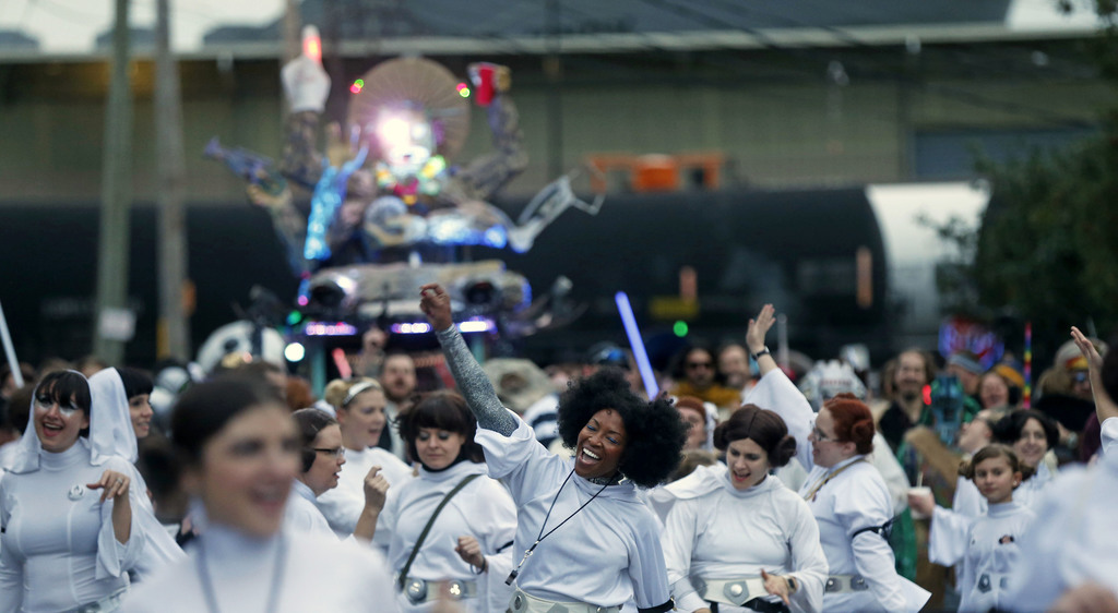 Members of the Krewe of Chewbacchus, a Mardi Gras Krewe, hold a parade with members dressed as Princess Leia, in honor of actress Carri...